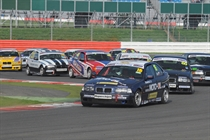 A huge field of Compact Cup cars on the International Circuit