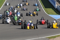 Formula Vee - a large fields of cars head for the first turn.