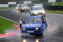 Classic Stock Hatch cars splashing through the mountain