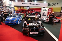 The front of the stand. BMW Compact Cup, Clio 182 Series and MR2 Championship cars in view.